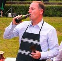 John Key having a beer