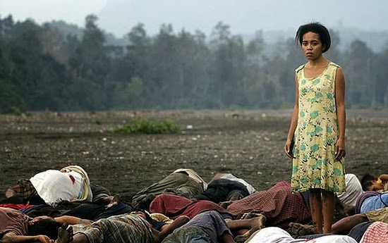 Beatriz looks for her husband among the bodies after the 1983 Kraras massacre, as portrayed in  Beatriz's War, East Timor's first feature film.
