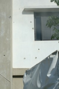 Bullet holes in a house at the Lebanese border town of Mashta. Locals say the Syrian government forces frequently fire across the border. Photo: Jon Stephenson.