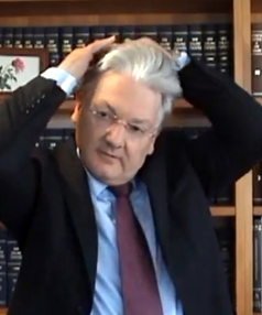 200511. News. Photo: screen grab from YouTube video. Peter Dunne combs his hair during a video blog where he makes comment about his hair.