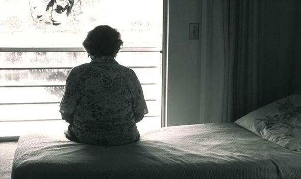 Elderly-person-alone-in-care-home-553213