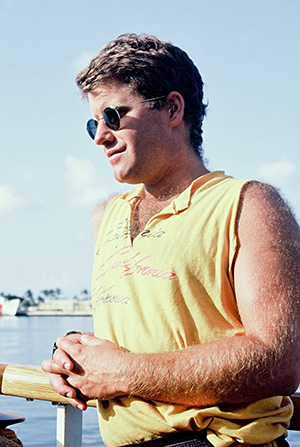 A younger Peter Willcox on board the first Rainbow Warrior in the Marshall Islands in 1985. Image: David Robie