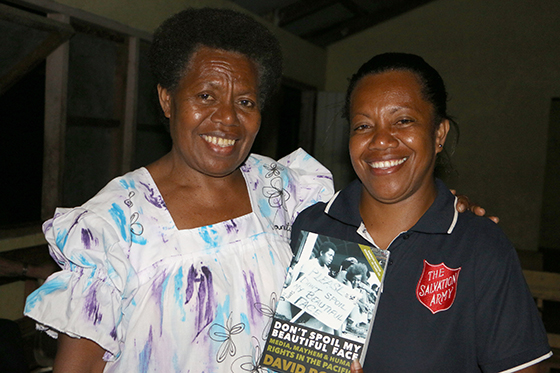 June Warigini and her copy of Don't Spoil My Beautiful Face with her and her mother, Annie Keitadi, featured in the cover photograph. Image: Del Abcede