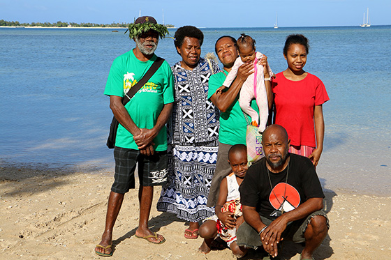 June (centre, holding her granddaughter Pauline Rose) and her family on Aneityum Island today. Image: Del Abcede