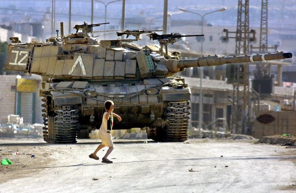 palestinian-child-throwing-rock-at-israeli-tank-photo-by-musa-al-shaer
