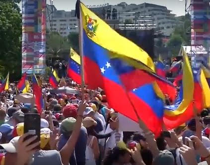 Surprise arrival of Russian plane to Venezuela fuels intrigue